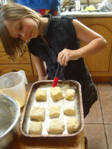 Athene brushing the scones with egg mixture